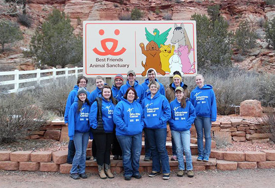 Madison College students on an alternative break trip to Best Friends Animal Sanctuary in southern Utah gather for a photograph.