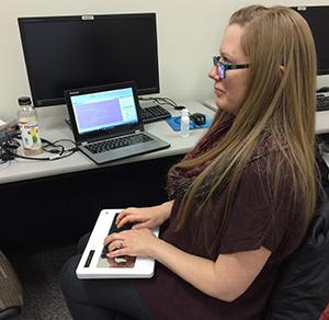 Jessica Bolanos, a fifth semester student in the court reporter program, demonstrates how the stenograph machine is used.