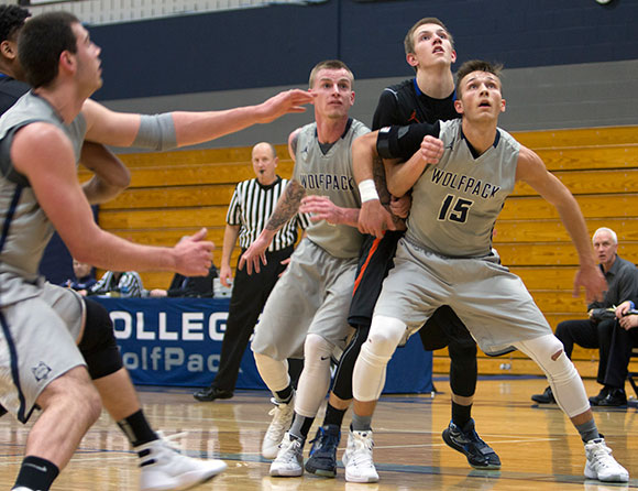 Madison College's Kristian Zimmerman (15) boxes out a Milwaukee Area Technical College player as he looks for a rebound.