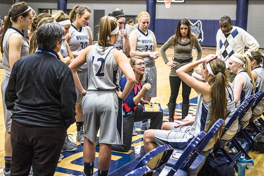 Madison College women's basketball coach Jessica Pelzel speaks to her team during a time out at a recent home game.