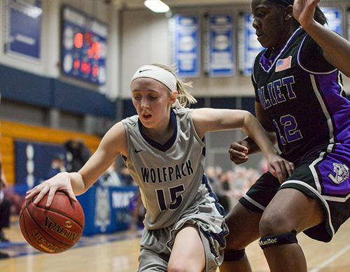 Kaitlyn Kast (15) dribbles past a Joliet Junior College defender during her team's home victory on Feb. 17. Madison College beat both Joliet and Rock Valley College to win the NJCAA Division II Regional IV title.