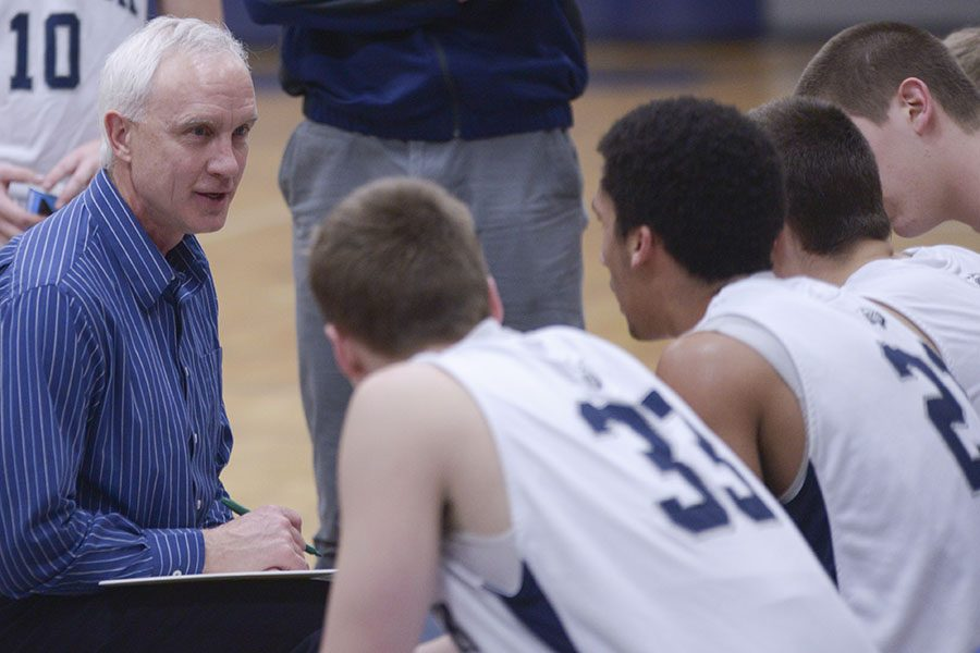 Scot Vesterdahl, left, is retiring after nearly 15 years at the helm of the Madison College men's basketball program.