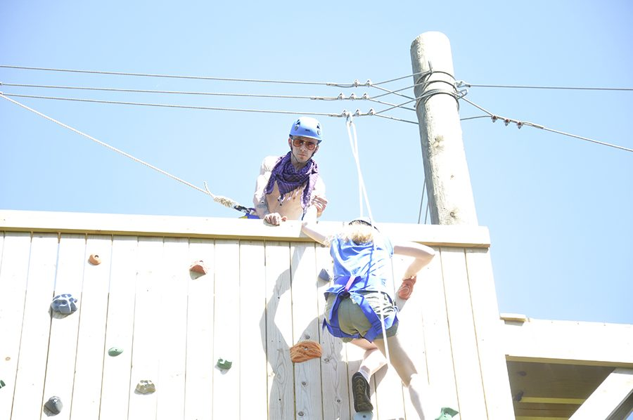 Clarion staff members Patrick Kempfer, top, and Elliott Puckette reach the top of the new Madison College climbing wall.