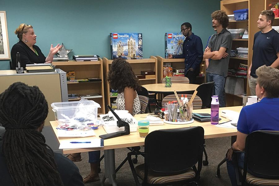 "Madison College Library Director Julie Gores gives members of the Student Activities Board a tour of ""The Creator Studio."""