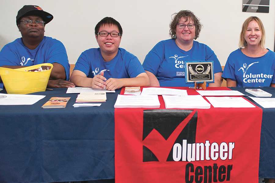 Members of the Madison College Volunteer Center promote the new Service Learning Academy during WolfPack Welcome