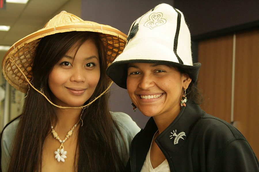 Students show the international hats they wore at the 2014 Global Showcase event held at the Truax Campus.