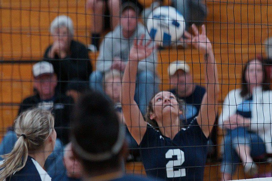 Madison College volleyball player Andrea Bauer (2) sets the ball for a teammate during a recent match at Redsten Gymnasium.