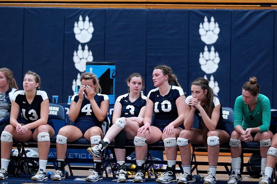 Members of the Madison College women's volleyball team gather their emotions after a loss to top-ranked Harper College in the NJCAA Division III Championship played in Redsten Gymnasium on Oct. 29.