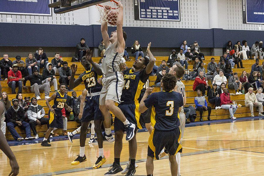 Madison College's Shane Walden slams home a dunk during his team's Nov. 22 home game against No. 2 ranked Rochester Community & Technical College. The WolfPack lost a close 84-75 contest.