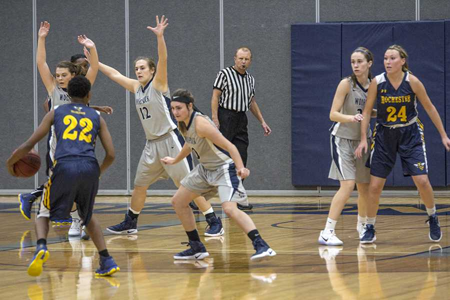Madison College's Rachel Slaney (14) and Megan Corcoran play defense on Nov. 22 against Rochester Community and Technical College. Ninth-ranked Rochester edged fifth-ranked Madison College, 70-68.