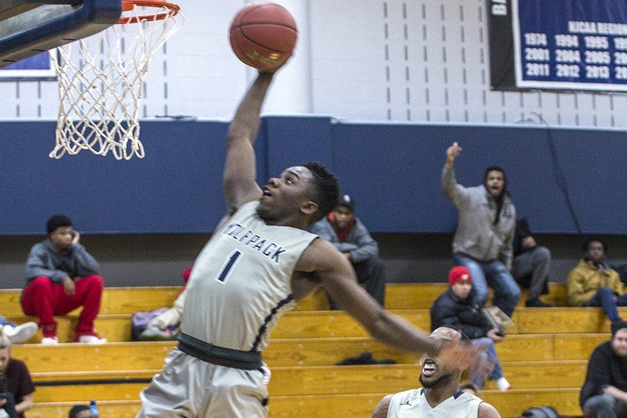 Tyree Young (1) goes in for a dunk during the Madison College men's basketball team's game against Milwaukee. The WolfPack is at 9-8 overall and 2-1 in conference play.