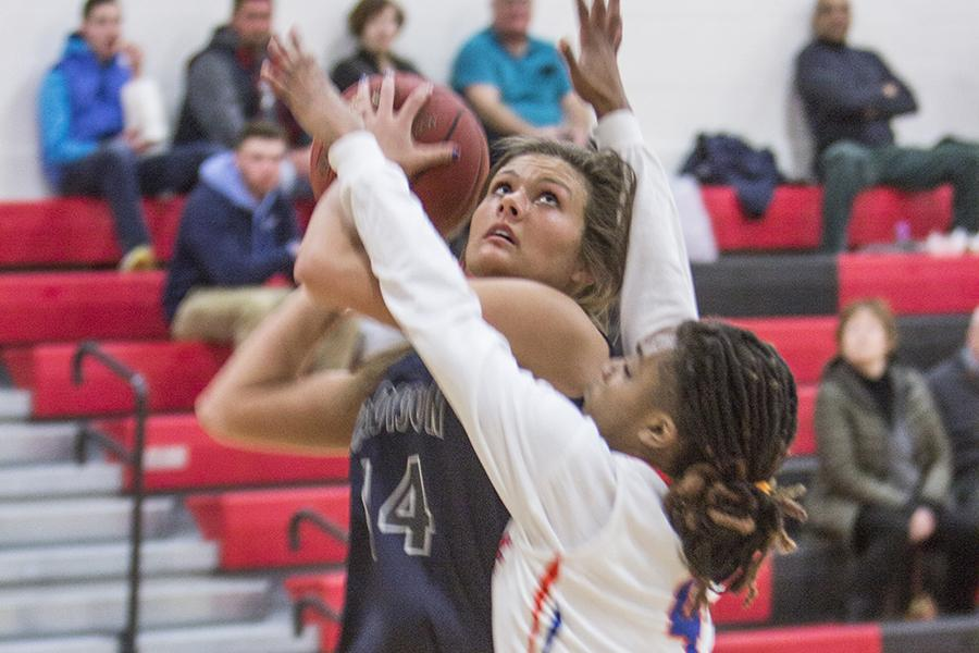 Madison College women's basketball player Rachel Slaney goes in for a basket against Milwaukee Area Technical College.