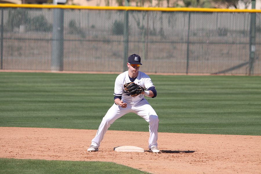 Madison College baseball player Cade Bunnell takes a throw at second base during one of the games the team played in Arizona over spring break.