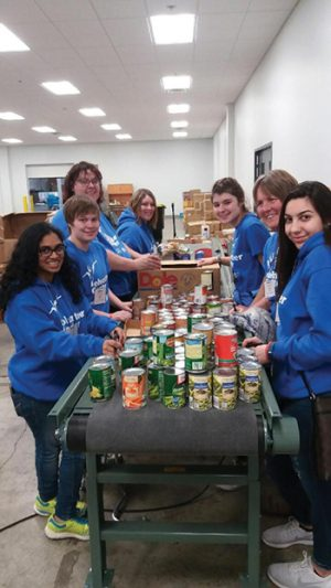 Members of the Volunteer Center participate in a service learning activity.