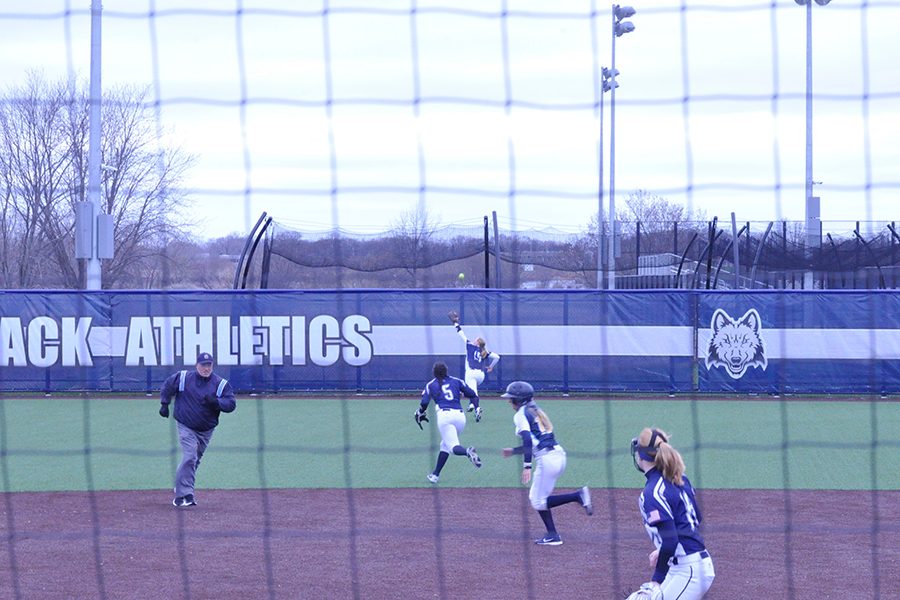 Madison College softball players react to a triple to right field hit by Rock Valley College's Madason Shaw on April 14.