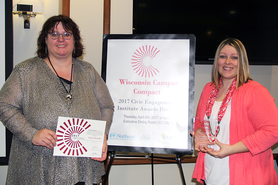 Madison College students Gloria Stendel, left, and Samantha Hunter display the awards they received at the annual Wisconsin Campus Compact Awards Dinner on April 6. Stendel was named a 2017 Newman Civic Fellow, while Hunter won the Jack Keating Student Civic Leadership Award.