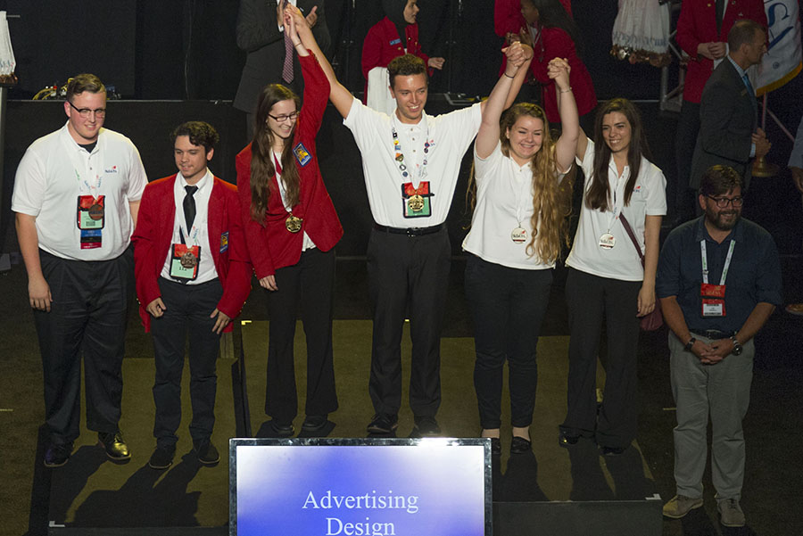 Allie+Christensen%2C+third+from+left%2C+joins+other+winners+in+the+%E2%80%9Cadvertising+design%E2%80%9D+competition+on+stage+at+the+SkillsUSA+national+competition+in+Louisville%2C+Ky.%2C+this+summer.
