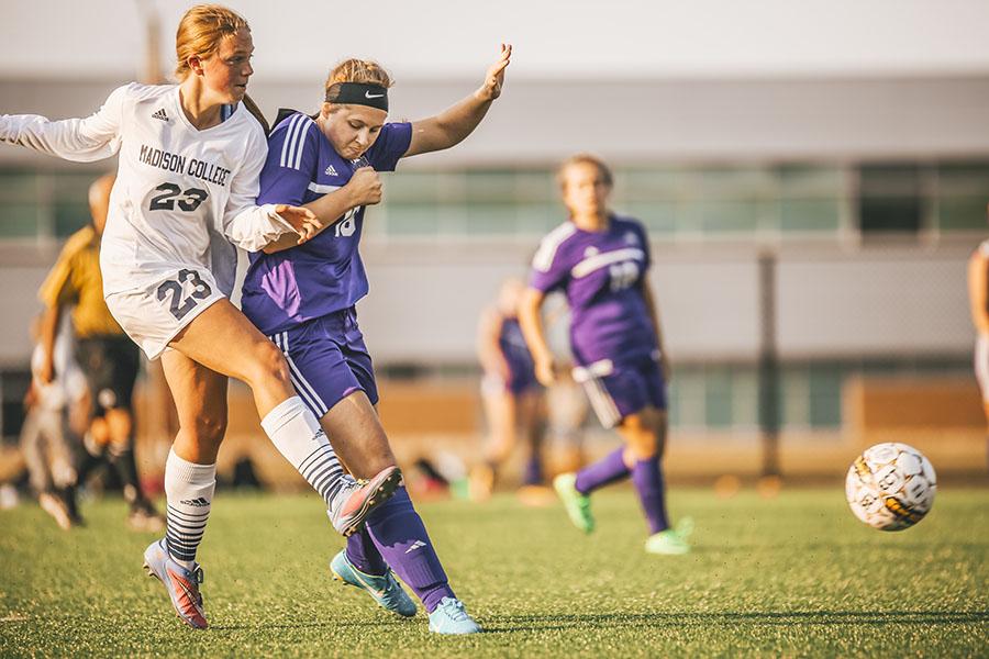 Madison College women's soccer player Anna Cappaert (23) kicks the ball away from an opponent during a recent match.