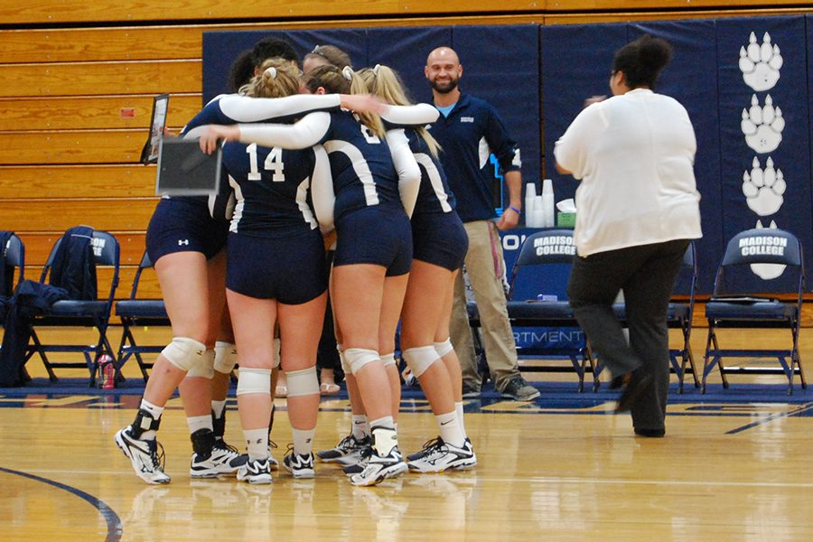 The sophomores on the volleyball team gather on the court after being recognized prior to their match against Milwaukee Area Technical College.