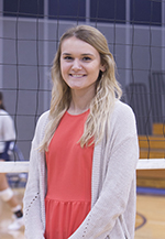 Former player Taylor Genthe enjoys her new coaching role.