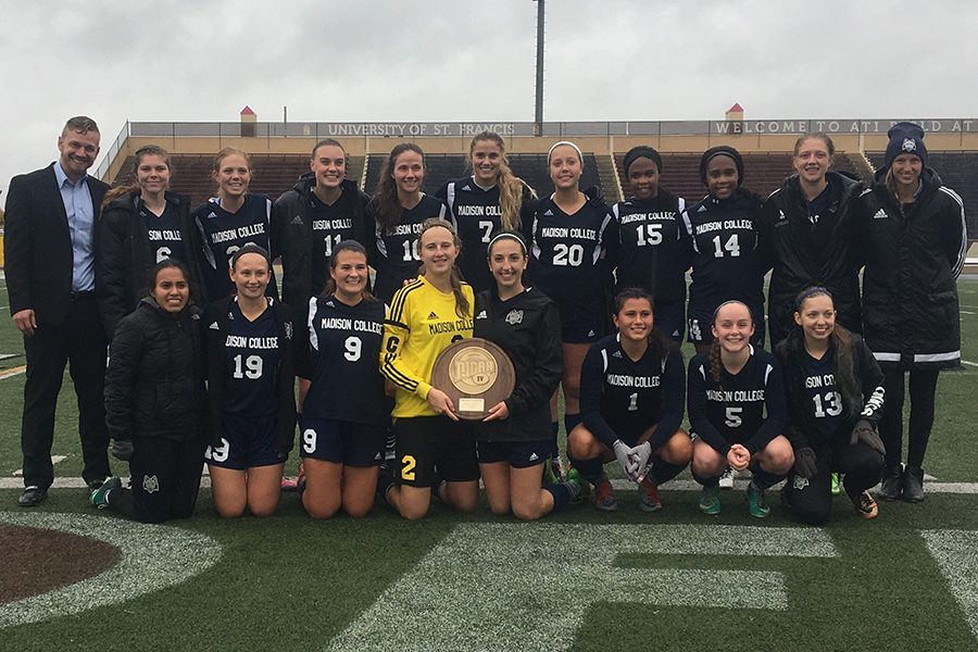 The Madison College women's soccer team celebrates winning the NJCAA Division III District D Championship.