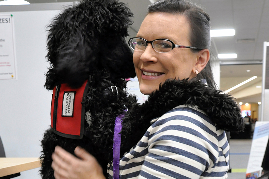 Juliet gives her trainer, Heather Morgan, a hug during a recent visit to the Madison College Student Life Center.