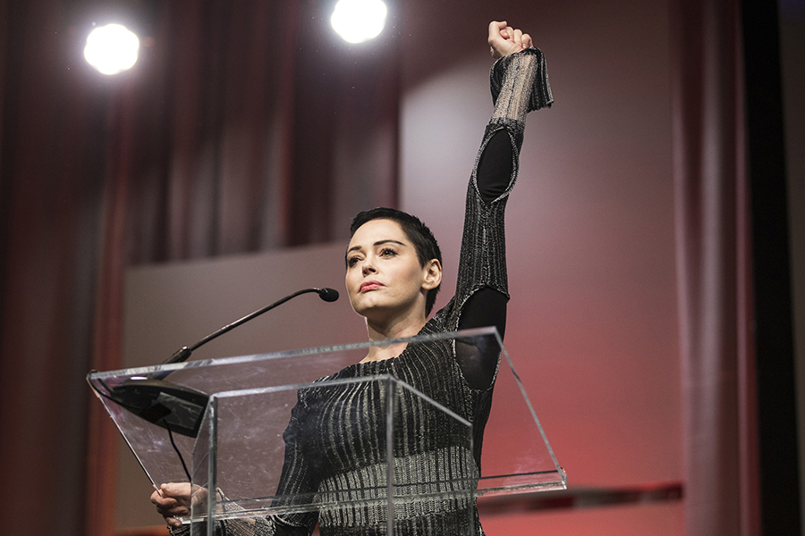 Rose McGowan raises her fist as she speaks during The Women's Convention at Cobo Center in downtown Detroit, Friday, Oct. 27, 2017.