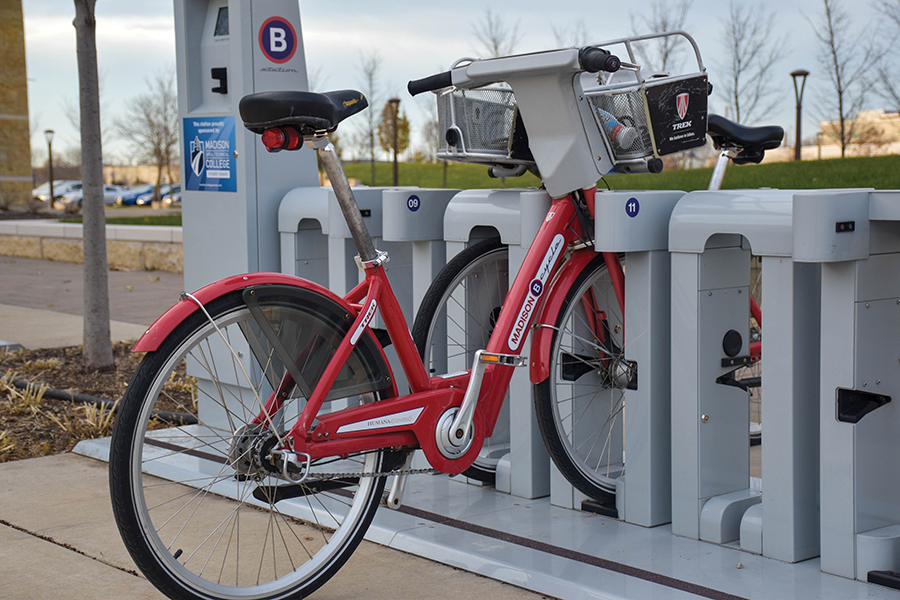 Madison College's BCycle station is located near the entrance to the Health Building at the Truax Campus.