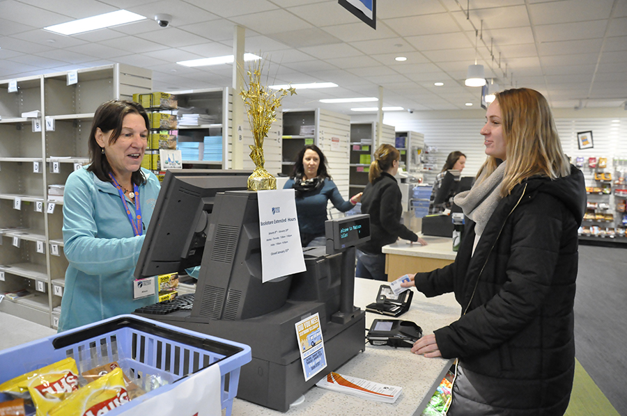 Student purchases textbooks at Truax Bookstore on Thursday, Jan. 11.