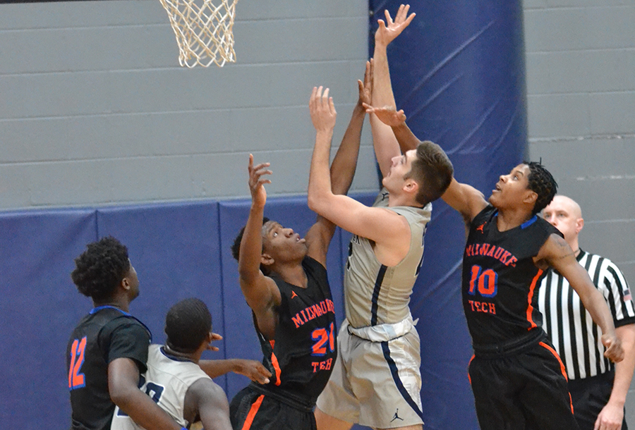 Madison College's Alex Easterday shoots over a Milwaukee Area Technical College defender during the WolfPack's 93-81 victory on Jan. 10.