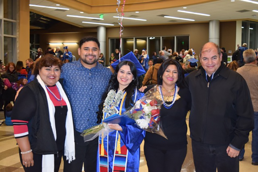 Vianey Hernandez, center, poses with her family at graduation. Hernandez was the student speaker at the mid-year graduation ceremony.