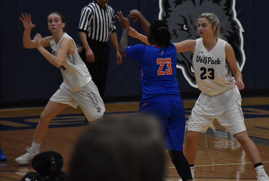 Madison College's Abby Meehan, 23, defends a Milwaukee opponent on Jan. 10 as Megan Corcoran, left, steps in to steal a pass.