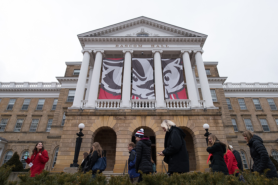 Students and visitors walk in front of Bascom Hill at the UW-Madison campus