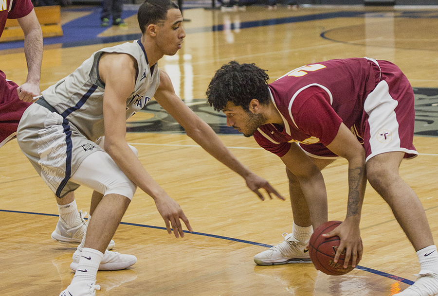 Madison College men's basketball player Marcus Riser defends a Triton College opponent during a recent game.