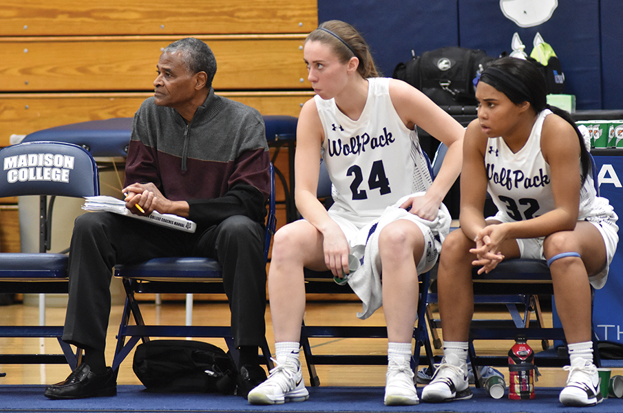 Madison College's assistant women's basketball coach Mike Mayfield, left, watches a recent game with players Megan Corcoran, center, and Tierra Sackett.