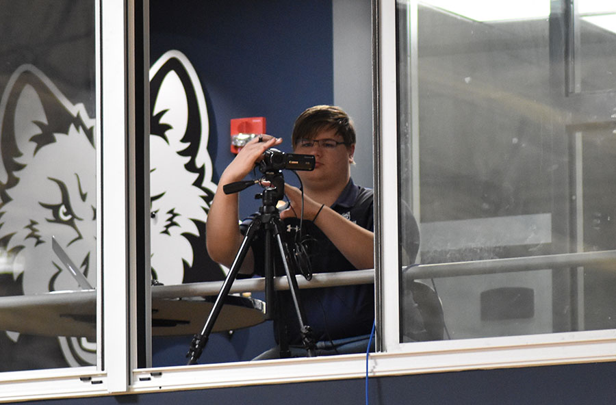 Student Matthew Webster is the man behind the scenes, broadcasting sporting events for the athletic department.