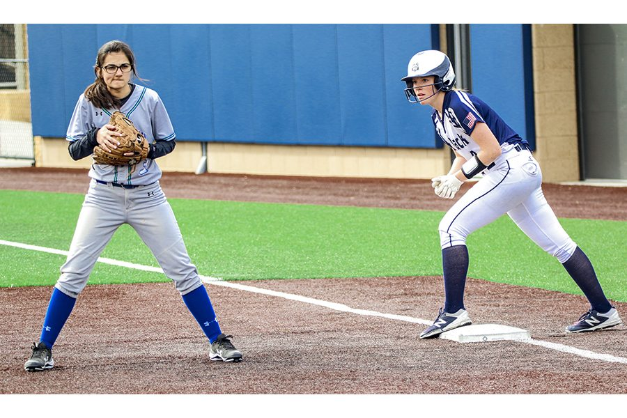 Madison+College%E2%80%99s+Ashley+Kniesel+eyes+the+pitcher+from+first+base+during+her+team%E2%80%99s+game+against+Bryant+and+Stratton+College.