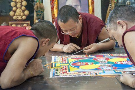 Monks create their artwork in Truax Campus Gateway