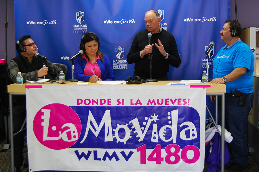 Madison College President Dr. Jack Daniels joins La Movida radio announcers on the air on April 20.
