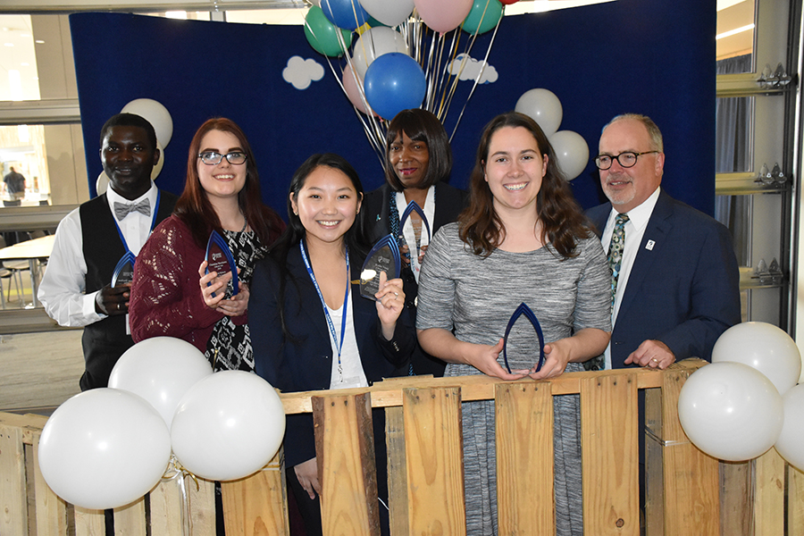 Karen Roberts Student Life Leadership award winners, from left, Ousman Darboe, Christina Marshalek, Kalia Vang, Katrina Willis and Jessica Pokrandt join Dr. Keith Cornille for a photo.