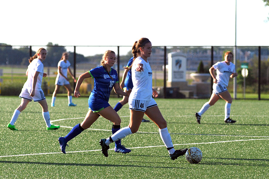 Peyton Trapino takes the ball upfield for the Madison College women's soccer team during a scrimmage in August 2018.