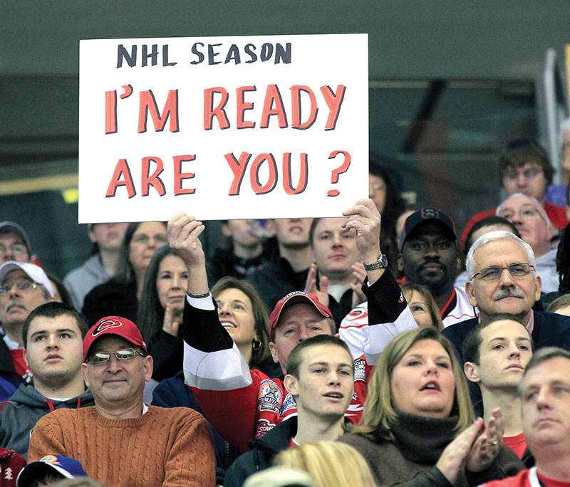 An+NHL+fan+holds+up+a+sign+at+an+AHL+game+during+the+2013+lockout%2C+encouraging+owners+and+players+to+make+a+deal.+There+are+now+signs+that+another+lockout+may+be+on+the+horizon.