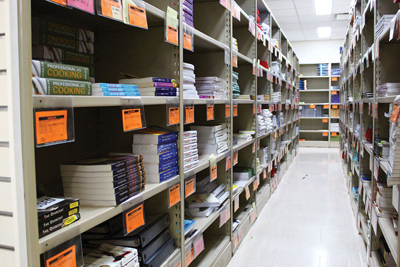 Textbooks rest on shelves at the Madison College bookstore until un-eager students line up to purchase them