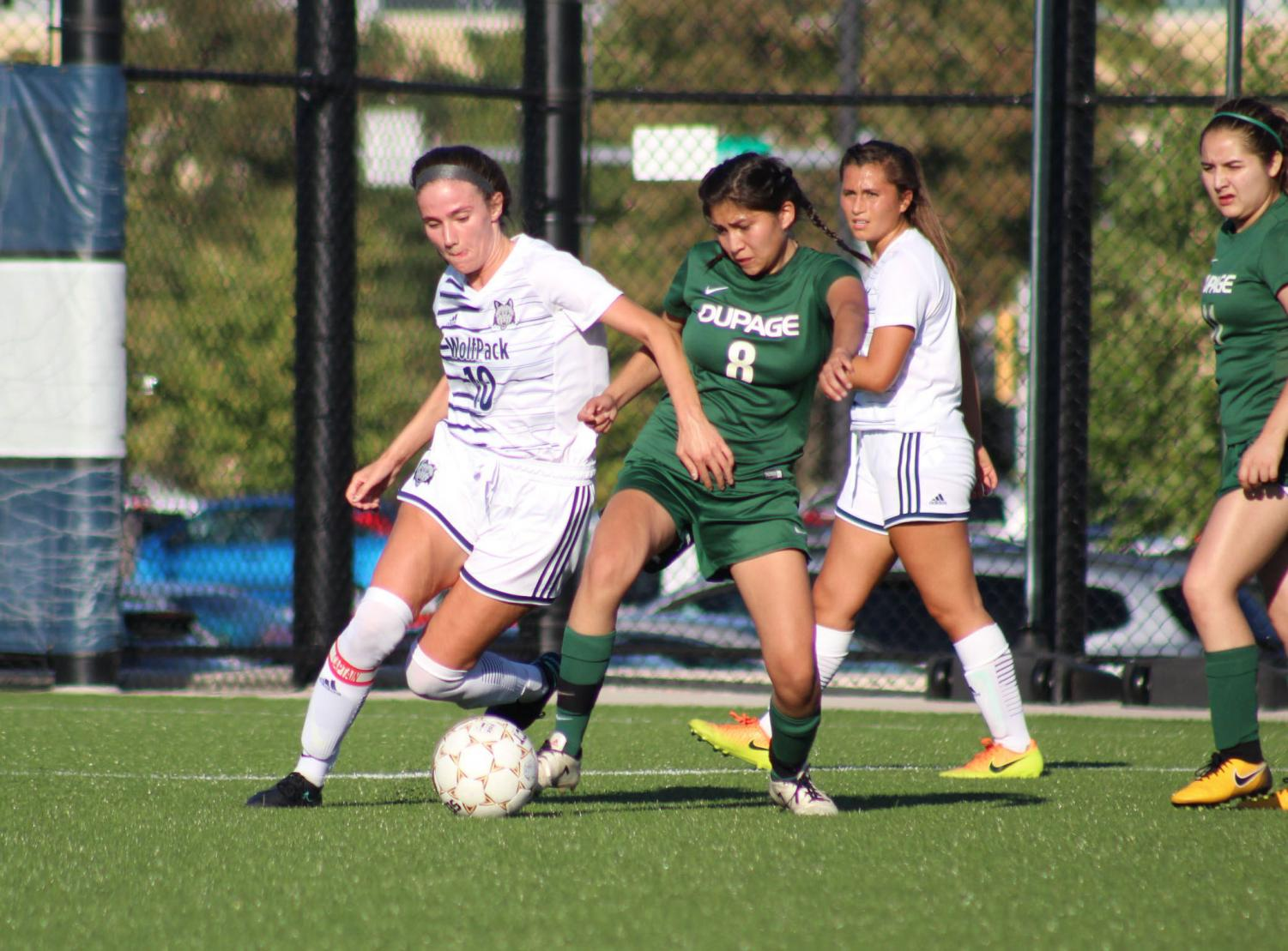 Madison College's Peyton Trapino fights a College of DuPage player for the ball during her team's 5-0 win at home on Sept. 10. The WolfPack women's soccer team is now 7-1 overall and 6-0 in conference play.