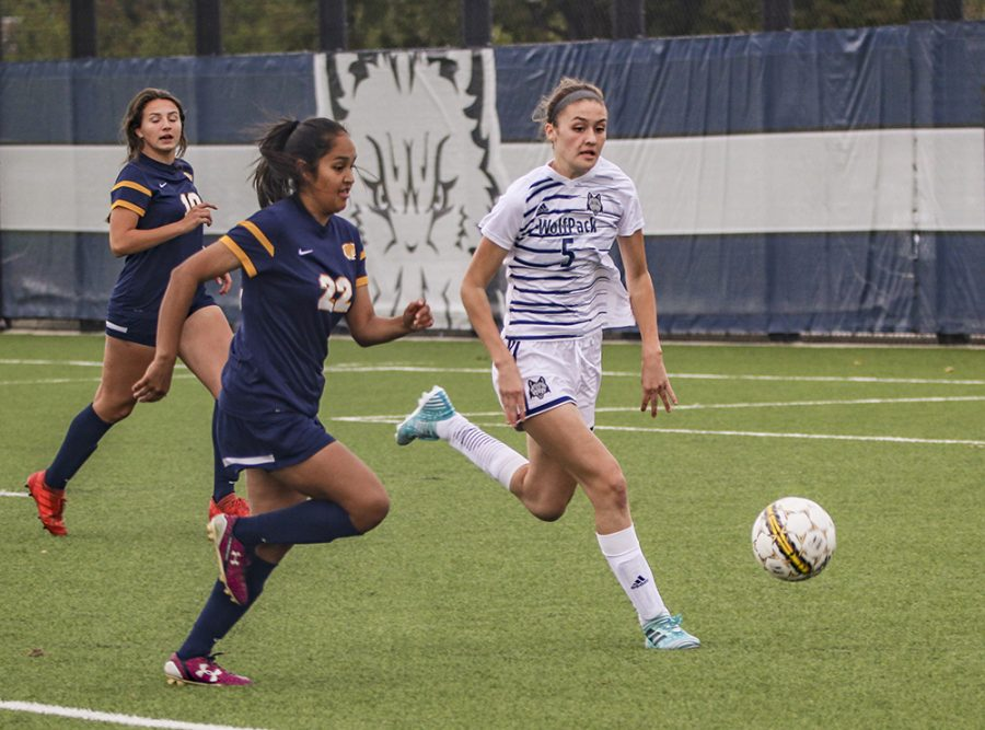 Madison College midfielder Mary Raemisch takes the ball away from an opponent