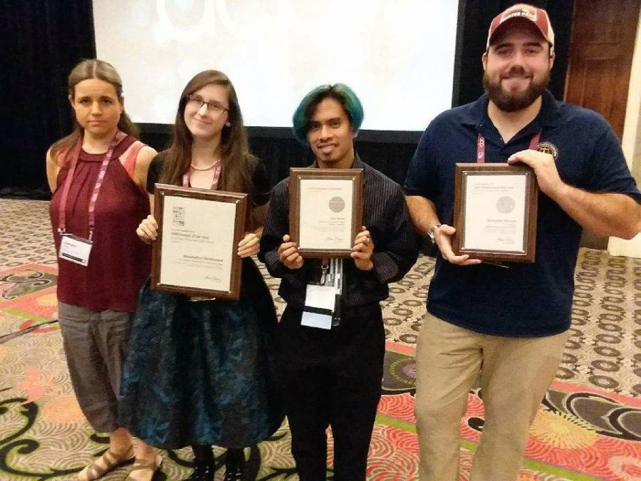 The+Clarion+received+seven+awards+at+the+Associated+Collegiate+Press+National+College+Media+Convention.+Pictured%2C+from+left%2C+are+staff+members+Damara+Gillett%2C+Alexandra+Christensen%2C+Andrew+Kicmol+and+Joe+Craker.