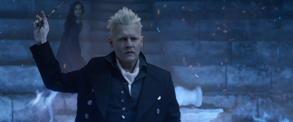 "Johnny Depp in the film ""The Crimes of Grindelwald."" In the film, Depp sports spiked bleached blond hair and eyes of two different colors, giving him a ghostly appearance."
