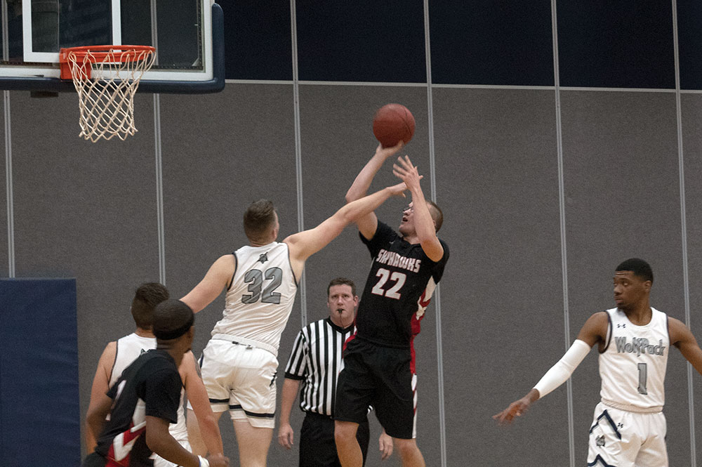 Madison College's Adam Anhold (32) tries to block the shot of a Sauk Valley Community College opponent during a men's basketball game on Nov. 14.