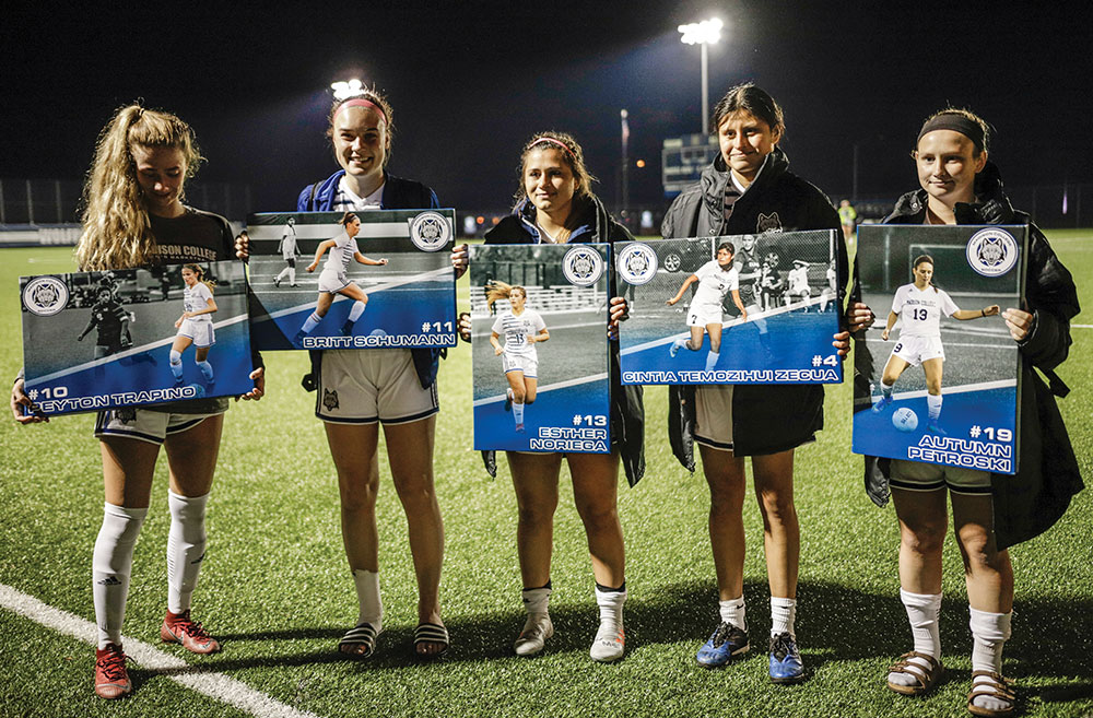 Sophomores on the Madison College women's soccer team hold the framed photos they were give prior to their final match. Pictured, from left, are Peyton Trapino, Britt Schumann, Esther Noriega, Cintia Temozihui Zecua, and Autumn Petroski.