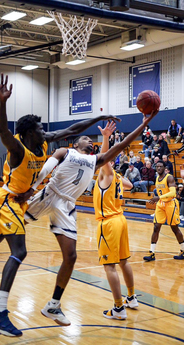 Madison College's Jalen Addison reaches around an opponent for a shot during a recent game.